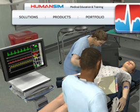 2 medical students practising treatment on a virtual patient using HumanSim