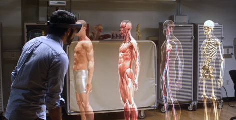 Male medical student learning about the human body, muscular and nervous system and skeleton in virtual reality