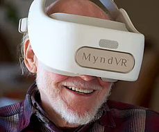 Old man wearing MyndVR headset and enjoying experience in virtual reality